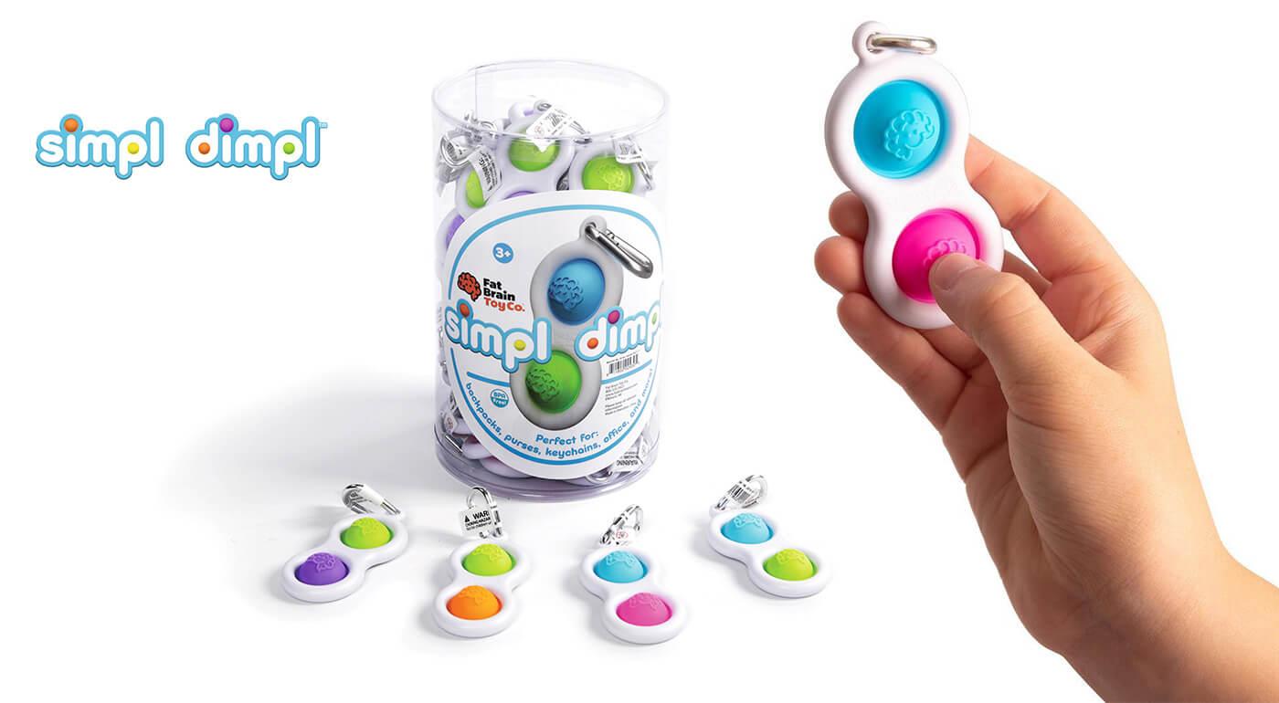 Simpl Dimpl - senzorická hračka, ktorú si zavesíte na kočík, tašku alebo kľúče