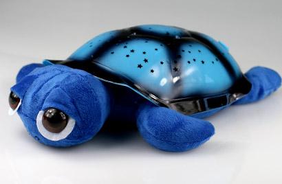 Hrajúca svietiaca korytnačka s otvorenými očkami - modrá
