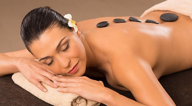 Klasická masáž, masáž lávovými kameňmi alebo permanentka na 3 vstupy