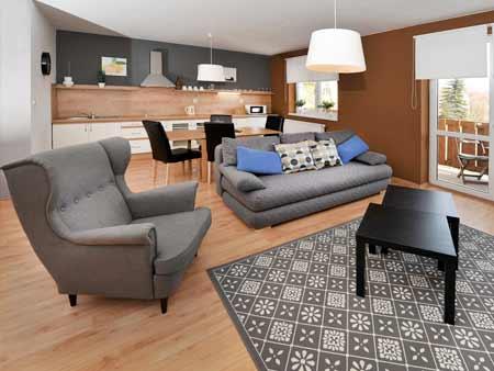 Pobyt pre 4 osoby na 3 dni (2 noci) v Apartmáne Tatry Holiday: 1x 90 minút sauna, minigolf pre štyri osoby, wellness poukážka, fľaša vína